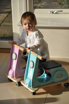 Katie chooses the pink scoot to ride.