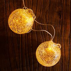 Rechargeable indoor-outdoor votives:  We love the art-meets-tech pairing of LED bulbs and handblown glass globes.    Available in 4 colors; amber with white bulbs shown (57 dollars for Aurora Glow solar collector and 6 2½-inch-wide globes with hooks on a 25-foot strong; from allsopgarden.com).
