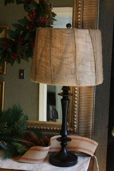 For the reading lamp by the chair - paint the base black, recover shade with burlap. Off to the fabric store.