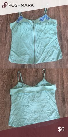 Forever 21 spaghetti strap zippered top Blue flowers embellish the aqua marine top. Copper zip-up. Short in length & great for high waist bottoms. 100% silk. Forever 21 Tops