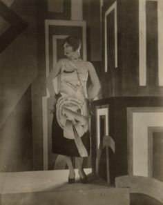 """Gilda Gray wearing an Art Deco dress designed by Louis Lozowick for the Lord & Taylor centennial, ca.. 1926. unidentified photographer. Louis Lozowick papers. """""""