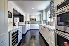 Contemporary Kitchen with Flat panel cabinets, Hardwood floors, Ceramic Tile, U-shaped, Flush, Wine refrigerator, Glass panel