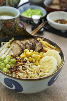 Hearty and flavorful Sapporo Style Miso Ramen topped with slices of teriyaki pork tenderloin, hard boiled eggs, bean sprouts, corn, and bamboo shoots. | Roti n Rice