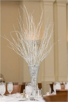 If you just want to add something to your venue to make it more fitting with a theme but you either don't have the budget or want a minimalist look these white twig tree centre pieces would be a good choice.