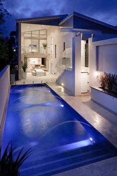 The openness of this home looks stunning. Fountains in the pool, blue hues, all beautiful. Luxury homes.