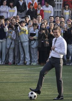 Hello, David Beckham's tailor. You might know that David wore your wonderful pants to China yesterday and they looked quite splendid on the soccer field.