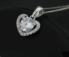 Very pretty clear crystal heart necklace. Clear Crystal, Bridal Jewelry, Engagement Rings, Sterling Silver, Crystals, Diamond, Heart, Pretty, Necklaces