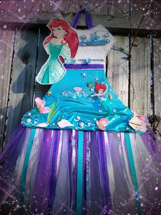My one of a kind Ariel inspired bow holder from the bodice to the very bottom I designed it myself my hairbow holders have great detail and are