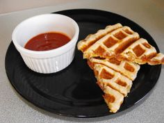 Pizza Pockets made in a waffle iron! Genius! Could use  a lot of different fillings as well, for variety. Definitely trying this.