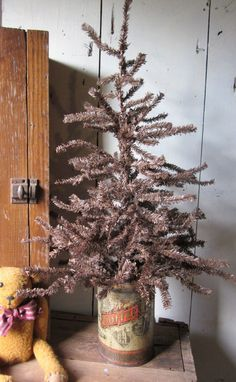 LOVE the vintage coffee tin holding this brown twiggy tree...AND...I just bought it!  The 1800 House Antiques rocks!