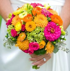 I'm contemplating a bright multi-color summer bouquet rather than trying to stick to specific theme colors. The great colors are what I love about flowers!