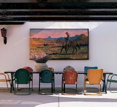 Diane Keaton dining room. Luv the miss matched chairs and cowboy art.
