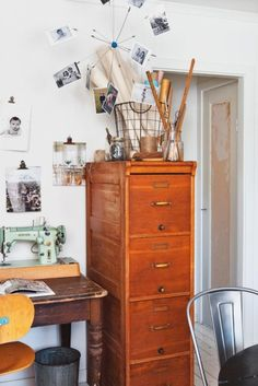 sewing machine. filing cabinet  Great idea and love the wooden file cabinet especially