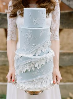 Ruffle and Feather Adorned Wedding Cake   Connie Whitlock Photography   Earthy and Elegant Rustic Wedding in Dusty Blue and Taupe - http://heyweddinglady.com/earthy-elegant-rustic-wedding-dusty-blue-taupe