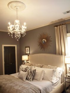 Beautiful Bedroom Design With Gray Walls Paint Color,crystal Chandelier,  Black Door And Mirrored Nightstands.