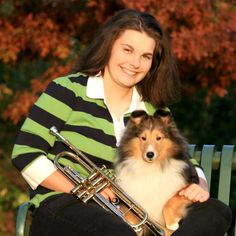 Girl with her two favorites! Music and her Sheltie.