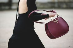 Metal ring handles are like jewelry for your bag. #refinery29 http://www.refinery29.com/2016/03/105661/paris-fashion-week-fall-winter-2016-street-style-pictures#slide-29