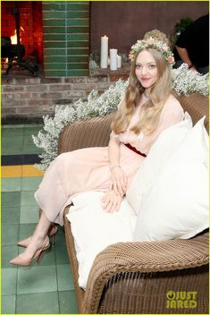 amanda seyfried playfully poses with a giant photo of herself 04 Amanda Seyfried wears a floral crown on her head while attending the Cle Deu Peau Beaute Spring 2015 Breakfast held at The Park on Tuesday morning (December 2) in…