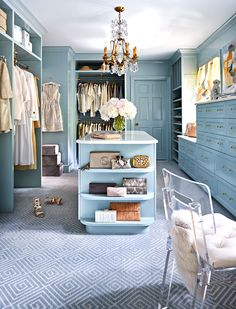 Oyster-blue walls bring beauty to this spacious closet | Photo: Dustin Peck / Design: Gray Walker