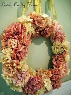 The flowers on this wreath are coffee filters!  I have a big ol' whopping stack of those in the studio which are totally useless for coffee making because I use a French press.  Wouldn't it be fun to dye them with the kids and make a new wreath?  Our naked door would appreciate it, too!