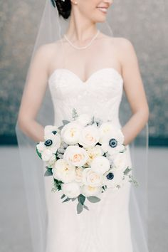 Wintery white anemone + rose bouquet: http://www.stylemepretty.com/missouri-weddings/st-louis/2016/01/25/classic-st-louis-opera-house-wedding/   Photography:  Mike Cassimatis - http://www.mnc-photography.com/