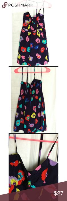 NWT American Eagle floral halter dress Flirty and beautiful summer halter dress.  Navy blue with multi colored flowers. Perfect for any occasion.  This item is brand new, never worn. American Eagle Outfitters Dresses