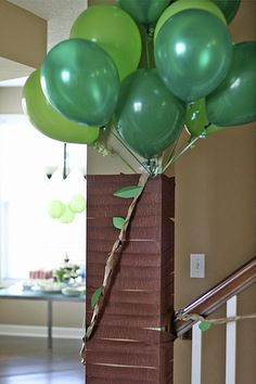 The Where the Wilds Things Are theme was a lot of fun. To transform the house into a jungle, I turned the large column by the staircase into a tree. I tied a bundle of green balloons to the base of the column. I used brown crepe paper to wrap the column to conceal the balloon strings and give the tree some bark.