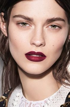 """Burgundy lips with minimalist eye makeup: lip color is """"Oxblood"""" by Burberry. (Photo: Burberry / 2016)"""