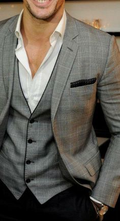 David Gandy wearing Grey Plaid Blazer, Grey Plaid Waistcoat, White Dress Shirt…