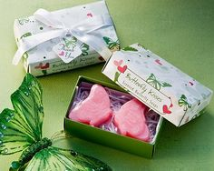 """Butterfly Kisses"" Scented Soaps Bring seasonal splendor to your wedding, bridal shower or any occasion with these butterfly inspired kissing soap favors. Rose Jasmine aroma. Wonderful shades of green on white detail intricate florals and butterfly bliss along with whimsical pink hearts on this high gloss designed favor box. White satin ribbon and bow adorn the gift packaging which also includes matching butterfly and heart themed Thank You tag."