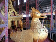 During the annual Phaung Daw Oo Festival a barge headed by a gilded swan carries five golden Buddha images around Inle Lake, Myanmar (Burma). Golden Buddha, Inle Lake, Swan, Image, Swans