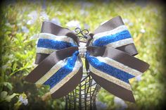black royal blue and silver cheer bow. See more at  Facebook Ribbons and Bows oh My or on our website http://ribbonsandbowsohmy.wix.com/ribbonsandbowsohmy