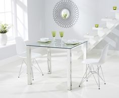 Buy the Sophie 90cm Glass Dining Table with Charles Eames Style DSR Eiffel Chairs at Oak Furniture Superstore