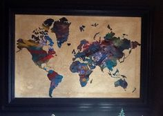 I saw the piece of art in the link ($262+ for the size I made, without a frame) and decided to make my own.  I used a painting I've had for a long time and painted over it, used a world map sticker, and spent about $50.00...  http://fineartamerica.com/products/world-map-watercolor-michael-tompsett-canvas-print.html