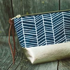 cosmetic bag with metallic tones, graphic pattern, & leather accents (image from bourbonandboots.com)