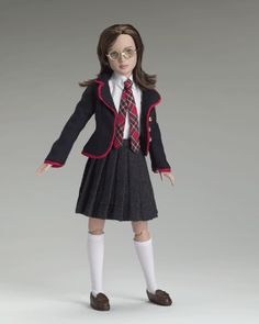 Prep School Marley Wentworth (2005)   DRESSED DOLL  LE1000   T5-M12D-02-001  $79.99   Designed by Tyler Wentworth®, Marley's preparatory school outfits arrived just in time for school photos. Marley wears the navy jacket and pleated gray flannel skirt with impeccable taste. A nod to the classic uniform, Tyler adds stylish touches such as red piping and brass buttons to the jacket. Complete with perfect loafers, and a necktie with the school's colors, Marley was a natural for the camera!