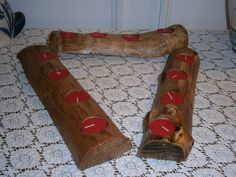 a Set Of 3 Rustic OAK Log 4 TEA LIGHT Candle Holders. $15.00, via Etsy.