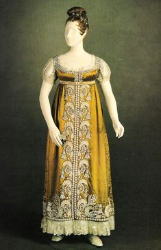 """Regency silk dress (called the """"Pearl Dress"""") with crimped white silk gauze decoration and beaded with faux pearls, c. 1817. This dress was owned by Princess Charlotte of Wales."""