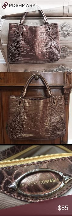 Metallic Brown Embossed croc leatherLarge Tote Great bag for work or travel fits a standard size folderCrocodile pattern Embossed All leather chestnut and copper leatherinterior has some discoloration but is clean from one of my favorite hand bag designers Francesco Biasia always great quality a detail Francesco Biasia Bags Totes