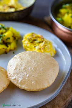 Puri, also spelled as Poori is an Indian fried bread made with three basic ingredients whole wheat flour (atta), salt, and water for kneading. Here are all the tips and tricks to make the perfect soft puffy and oil free poori. Also included a hack for that perfect round shape of poori! #indian #bread #vegan #instant