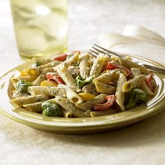 Creamy Basil Pasta With Chicken & Vegetables. Creamy basil sauce smothers pasta, chicken and vegetables for a healthy hearty family meal in this recipe.