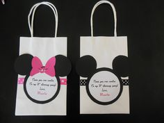 Thank you gift bags.  Basic white bags from party city with polka dot ribbon glued on front.  Cut out mickey mouse with custom message center and bow and sparkle for girls. (download minnie mouse font to print)