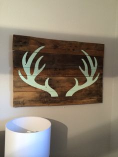 Beautifully simple antlers hand painted in the color of your choice on reclaimed wood. Each sign is approximately Because we use reclaimed wood and signs are hand painted no two are exactly alike. Pallet Crafts, Pallet Art, Wood Crafts, Hirsch Silhouette, Diy Home Decor, Room Decor, Pallet Creations, Kids Wood, My New Room