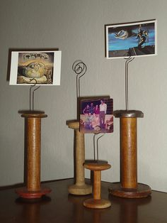 Antique spools made into picture holders.