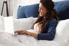 Happy casual beautiful woman with spread hands working on a laptop laying on the bed in the bedroom Funny One Liners, Remote, Random Stuff, Laptop, Beautiful Women, Hands, Woman, Bedroom, Stylish