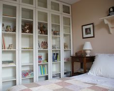 An entire wall lined with Ikea Billy Bookcases (with the optional glass doors)