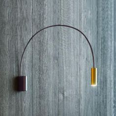 The Estiluz Volta LED Wall Sconce takes its cue from the reach of an arc lamp, only places it on the wall. The thin structure looks like wire, when in fact it is made from Aluminum. The curved stem places the light directly below for task-oriented spaces, and for added convenience, can be adjusted left to right 180 degrees.