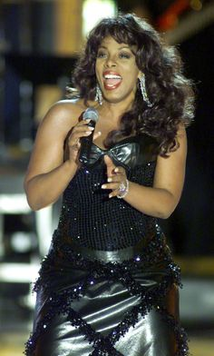 "Donna Summer ...  performs on stage at a taping of the VH-1 special, ""VH-1 Divas 2000: A Tribute to Diana Ross"" in New York's Madison Square Garden, April 9. Summer along with musicians Mariah Carey, Faith Hill, and Diana Ross herself each sang songs previously performed by Ross..."