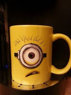 Minion coffee mug  You always need a cup that makes you smile! :) I WANT THISSS!!