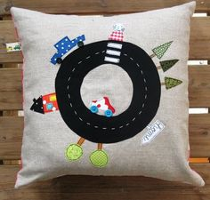 This is a darling nursery pillow and theme.